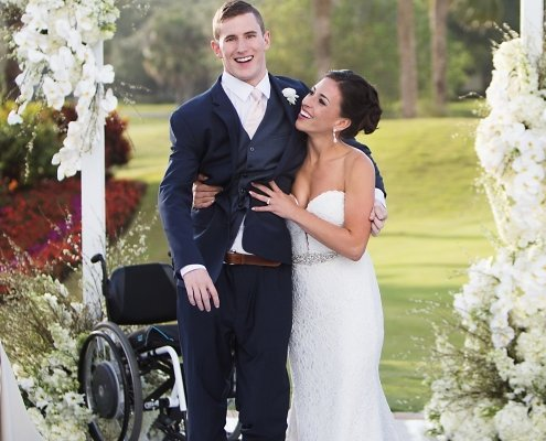 chris norton walks down aisle with his wife